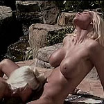 Blonde strap on lovers in action outdoors