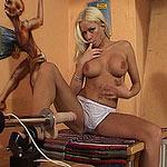 Blonde babe sucking a robot-dildo
