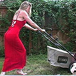 Housewife mowing lawn getting frisky