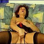 Dirty horny masturbating granny in black thigh highs