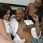 Sexy brunette lapping a bald black pussy