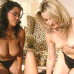 A Latina babe and her white friend get it on