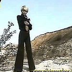 Blond teen in tie and suit pissing in suburbs
