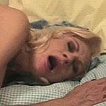 Horny granny gets fucked from behind on bed