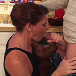 Mature brunette sucking his massive rod