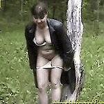 Brunette teen pissing in autumn forest standing
