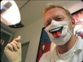 masked dentist